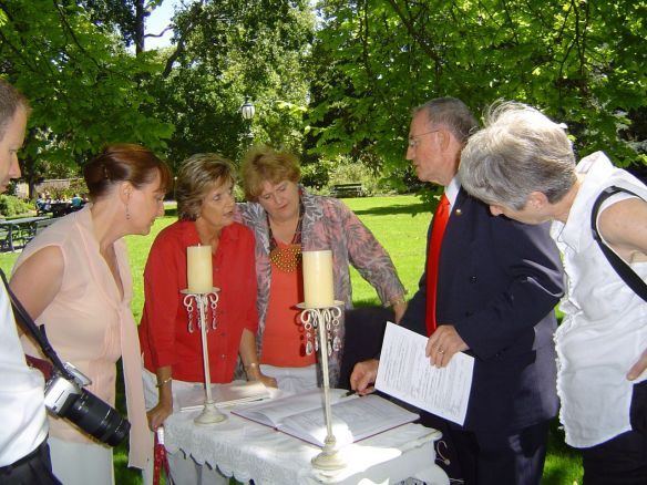 Celebrant, having just completed a marriage ceremony, explains procedures to student and new celebrants.